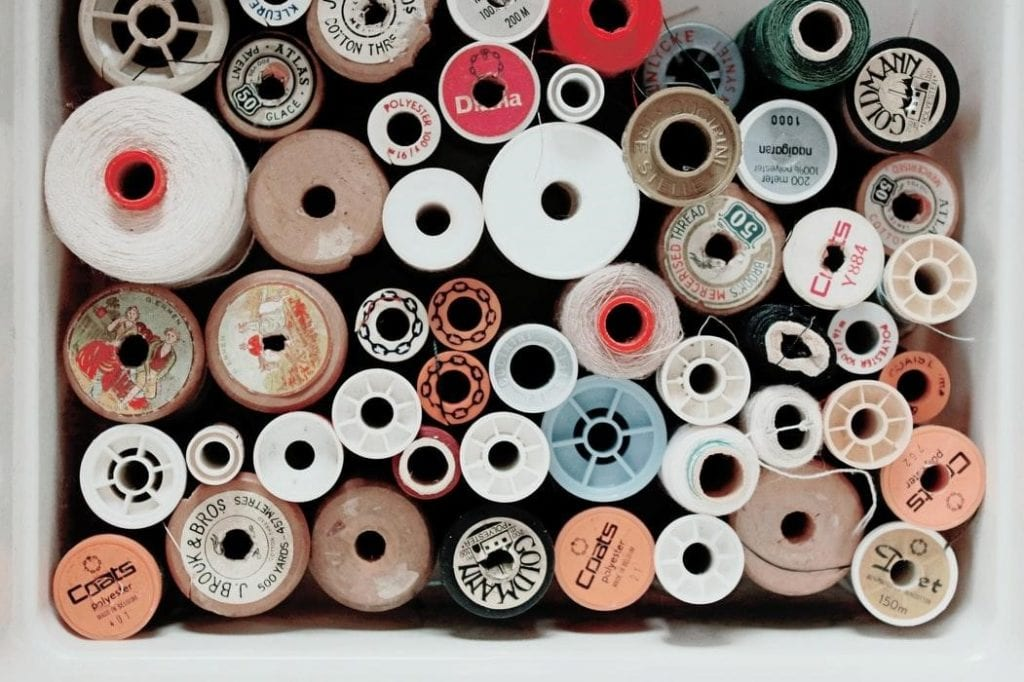 A box full of threads of different colors and sizes.