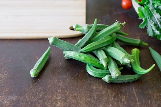 A bunch of okra lying on the table, as it is going to be used to make prints by dipping in paint