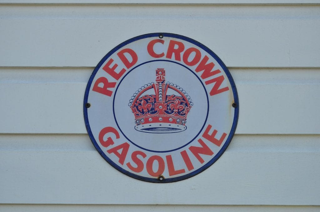A blue oval with a red and blue crown at the center that reads Red Crown Gasoline