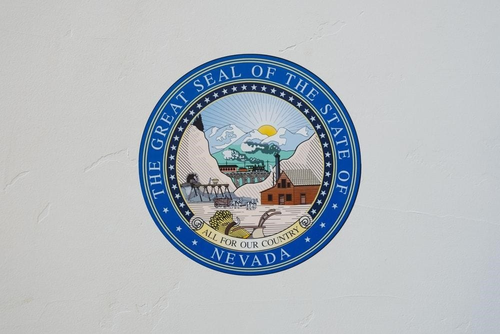A blue seal of the Nevada state that represents their mineral resources