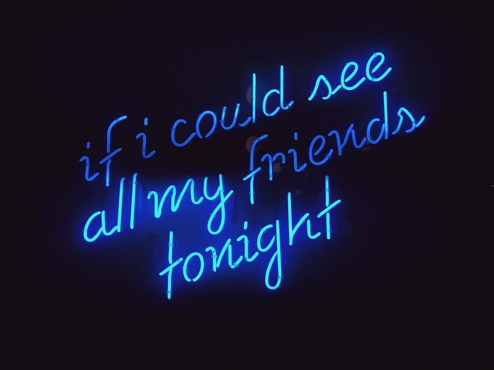 – A blue neon sign with a missing friends quote
