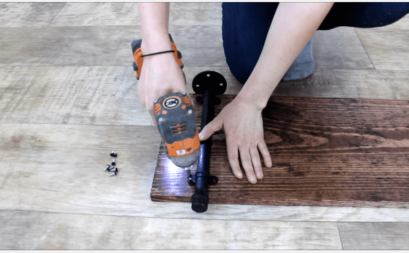 Step 4b fixing pipe on wooden board