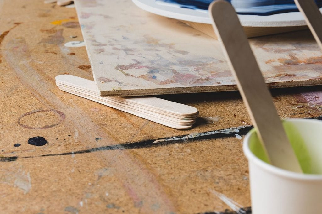 Use Paint Stirrers To Prevent Denting The Wood With Your Clamps