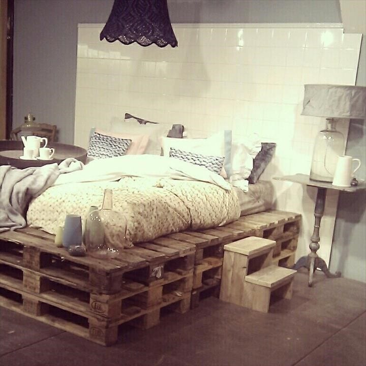 Layered Pallet Frame Bed With White Tile Background